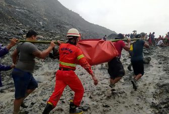 epa08522227 A handout photo made available by the Myanmar Fire Services Department shows rescue workers carrying the body of a victim after a landslide accident at a jade mining site in Hpakant, Kachin State, Myanmar, 02 July 2020. According media reports, search and rescue efforts are ongoing after a landslide was triggered by heavy rain in the area.  EPA/Myanmar Fire Services Department HANDOUT  HANDOUT EDITORIAL USE ONLY/NO SALES