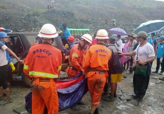epa08522220 A handout photo made available by the Myanmar Fire Services Department shows rescue workers carrying the body of a victim after a landslide accident at a jade mining site in Hpakant, Kachin State, Myanmar, 02 July 2020. According media reports, search and rescue efforts are ongoing after a landslide was triggered by heavy rain in the area.  EPA/Myanmar Fire Services Department HANDOUT  HANDOUT EDITORIAL USE ONLY/NO SALES