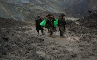 Myanmar soldiers recover bodies near the landslide area in the jade mining site in Hpakhant in Kachin state on July 2, 2020. - The battered bodies of more than 120 jade miners were pulled from a sea of mud after a landslide in northern Myanmar on July 2 after one of the worst-ever accidents to hit the treacherous industry. (Photo by Zaw Moe Htet / AFP) (Photo by ZAW MOE HTET/AFP via Getty Images)