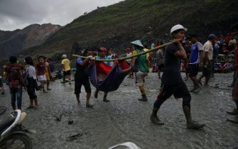 Rescuers recover bodies near the landslide area in the jade mining site in Hpakhant in Kachin state on July 2, 2020. - The battered bodies of more than 120 jade miners were pulled from a sea of mud after a landslide in northern Myanmar on July 2 after one of the worst-ever accidents to hit the treacherous industry. (Photo by Zaw Moe Htet / AFP) (Photo by ZAW MOE HTET/AFP via Getty Images)