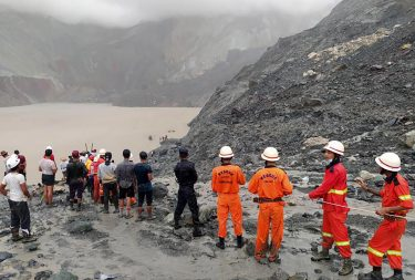 epa08522224 A handout photo made available by the Myanmar Fire Services Department shows rescue workers searching for people after a landslide accident at a jade mining site in Hpakant, Kachin State, Myanmar, 02 July 2020. According media reports, search and rescue efforts are ongoing after a landslide was triggered by heavy rain in the area.  EPA/Myanmar Fire Services Department HANDOUT  HANDOUT EDITORIAL USE ONLY/NO SALES