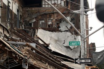 NEW YORK, NEW YORK - JULY 01: A three story building that housed the Body Elite Gym on the corner of Court and Union Streets collapsed on July 1, 2020 in the Carroll Gardens neighborhood of the Brooklyn borough of New York City. The collapse sent debris flying onto the sidewalk but no major injuries were reported. (Photo by Justin Heiman/Getty Images)