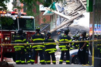NEW YORK, NEW YORK - JULY 01: New York City Fire Department (FDNY) work at the scene after a three story building that housed the Body Elite Gym on the corner of Court and Union Streets collapsed on July 1, 2020 in the Carroll Gardens neighborhood of the Brooklyn borough of New York City. The collapse sent debris flying onto the sidewalk but no major injuries were reported. (Photo by Justin Heiman/Getty Images)