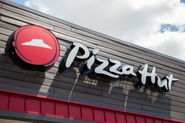 SHREVEPORT, LA - JUNE 29:  A view of a  Pizza Hut Logo on June 29, 2018 in Shreveport, Louisiana.  (Photo by Shannon O'Hara/Getty Images for Pizza Hut)