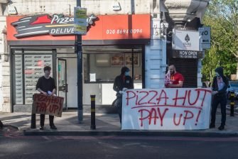 LONDON, ENGLAND - APRIL 25: Following the closure of several Pizza Hut restaurants due to Covid-19, the Croydon Solidarity Network protest outside in Lewisham over the plight of around forty Pizza Hut workers in South London who had not been paid for five weeks without being furloughed on April 25, 2020 in London, England. The British government has extended the lockdown restrictions first introduced on March 23 that are meant to slow the spread of COVID-19. (Photo by Guy Smallman/Getty Images)