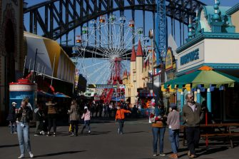 SYDNEY, AUSTRALIA - JULY 03: Guests visit Luna Park following a period of lockdown on July 03, 2020 in Sydney, Australia. Sydney's Luna Park has reopened to the public following its temporary closure on Monday 23 March in response to the COVID-19 pandemic. Restrictions on entertainment venues, weddings, community sport and other gatherings have been eased across NSW since 1 July, but strict physical distancing measures remain in place. (Photo by Lisa Maree Williams/Getty Images)