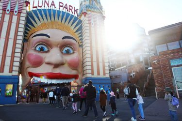 SYDNEY, AUSTRALIA - JULY 03: Customers are seen returning to  Luna Park on July 03, 2020 in Sydney, Australia. Sydney's Luna Park has reopened to the public following its temporary closure on Monday 23 March in response to the COVID-19 pandemic. Restrictions on entertainment venues, weddings, community sport and other gatherings have been eased across NSW since 1 July, but strict physical distancing measures remain in place. (Photo by Lisa Maree Williams/Getty Images)