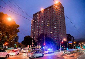Police vehicles park outside one of nine public housing estates which have been locked down in Melbourne on July 4, 2020 with more than 3000 residents in 1,345 units required to stay home due to an outbreak of the COVID-19 coronavirus. - The Australian state of Victoria recorded its second-highest daily increase in coronavirus cases, with 108 people diagnosed with the virus. (Photo by William WEST / AFP) (Photo by WILLIAM WEST/AFP via Getty Images)