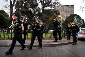 Police gather outside one of nine public housing estates which have been locked down in Melbourne on July 4, 2020 with more than 3000 residents in 1,345 units required to stay home due to an outbreak of the COVID-19 coronavirus. - The Australian state of Victoria recorded its second-highest daily increase in coronavirus cases, with 108 people diagnosed with the virus. (Photo by William WEST / AFP) (Photo by WILLIAM WEST/AFP via Getty Images)