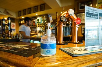 FALMOUTH, ENGLAND - JULY 4:  Sanitizer gel dispenser sits on the bar at the Chain Locker pub as it reopens for business on July 4, 2020 in Falmouth, Cornwall, United Kingdom. The UK Government announced that Pubs, Hotels and Restaurants can open from Saturday, July 4th providing they follow guidelines on social distancing and sanitising. (Photo by Hugh R Hastings/Getty Images)