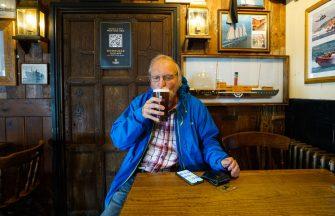 FALMOUTH, ENGLAND - JULY 4:  Richard Cranage returns to his local pub the Chain Locker, for a pint of his favourite ale, after it reopened for business on July 4, 2020 in Falmouth, Cornwall, United Kingdom. The UK Government announced that Pubs, Hotels and Restaurants can open from Saturday, July 4th providing they follow guidelines on social distancing and sanitising. (Photo by Hugh R Hastings/Getty Images)