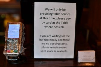 Safety instructions are displayed at the The Shy Horse pub and restaurant in Chessington, Greater London on July 4, 2020, on the first day of a major relaxation of lockdown restrictions during the novel coronavirus COVID-19 pandemic. - Pubs and restaurants reopen as part of a wider government plan to relaunch the hospitality, tourism and culture sectors and help the UK economy recover from more than three tough months of lockdown. (Photo by Ben STANSALL / AFP) (Photo by BEN STANSALL/AFP via Getty Images)