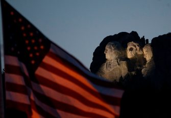 The US flag is seen with Mount Rushmore National Monument during an Independence Day event attended by the US president in Keystone, South Dakota, July 3, 2020. (Photo by ANDREW CABALLERO-REYNOLDS / AFP) (Photo by ANDREW CABALLERO-REYNOLDS/AFP via Getty Images)