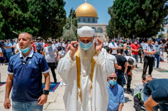Palestinian Muslims perform friday prayer outside the Dome of the Rock Mosque, in Jerusalem's Al-Aqsa mosques compound on July 3, 2020, during the novel coronavirus pandemic. (Photo by AHMAD GHARABLI / AFP) (Photo by AHMAD GHARABLI/AFP via Getty Images)