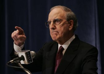 Investigator George J. Mitchell announces results of his 20-month investigation into performance-enhancing drug use in baseball, 13 December 2007, at a press conference in New York. Some of baseball's most prominent stars, including legendary pitcher Roger Clemens, were labelled as drug users on Thursday as George Mitchell's long-awaited report on steroids in the sport was made public. Mitchell said there has been widespread anabolic steriod use for more than a decade and that all 30 Major League teams have one or more players using performance enhancing drugs. AFP PHOTO/Stan HONDA (Photo credit should read STAN HONDA/AFP via Getty Images)