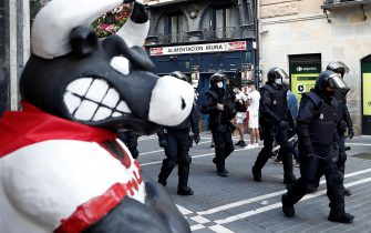 epa08530495 Several riot policemen patrol in the surroundings of City Hall's square in Pamplona, northern Spain, 06 July 2020. Sanfermines should begin 06 July at noon with a rocket fired from the balcony of the City Hall, but the festival was canceled due to the pandemic coronavirus COVID19 crisis.  EPA/Jesus Diges