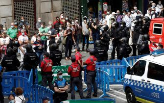 epa08530589 Security forces control the access to City Hall square in Pamplona, northern Spain, 06 July 2020. Sanfermines should begin 06 July at noon with a rocket fired from the balcony of the City Hall, but the festival was canceled due to COVID19.  EPA/Jesus Diges
