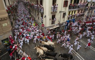 PAMPLONA, SPAIN - JULY 07: Revellers run with Puerto de San Lorenzo's fighting bulls during the second day of the San Fermin Running of the Bulls festival on July 7, 2018 in Pamplona, Spain. The annual Fiesta de San Fermin, made famous by the 1926 novel of US writer Ernest Hemmingway entitled 'The Sun Also Rises', involves the daily running of the bulls through the historic heart of Pamplona to the bull ring. (Photo by Pablo Blazquez Dominguez/Getty Images)