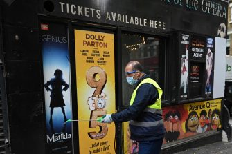 epa08530560 A worker cleans a closed theatre ticket agent booth in the West End of London, Britain, 06 July 2020. Britain's government has announced a 1.57bn pounds emergency support package to help protect the futures of theatres, galleries and museum across the country. Many arts institutions are facing financial difficulty due to the ongoing coronavirus pandemic.  EPA/NEIL HALL