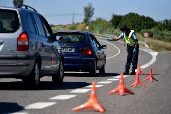 A member of the Catalan regional police force Mossos d'Esquadra controls a checkpoint on the Corbins highway near Lleida on July 4, 2020. - Spain's northeastern Catalonia region locked down an area with around 200,000 residents around the town of Lerida following a surge in cases of the new coronavirus. (Photo by Pau BARRENA / AFP) (Photo by PAU BARRENA/AFP via Getty Images)