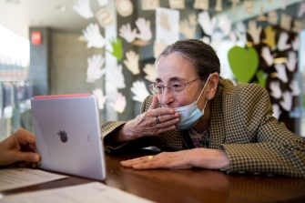 GRANADA, SPAIN - JUNE 01: Mari Carmen 79, kisses via videocall her family during her first family visit in DomusVii El Serrallo nursing home on June 01, 2020 in Granada, Spain. The DomusVi El Serrallo nursing home in Granada has started a program of face-to-face visits. Elderly users can receive family visits after three months of strict lockdown. Due Covid-19 pandemic, over 18,000 eldery people have died in nursing homes in Spain. (Photo by Carlos Gil Andreu/Getty Images)