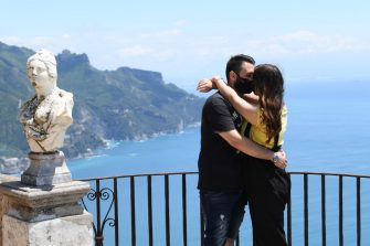 RAVELLO AMALFI COAST, ITALY - JUNE 06: A couple of tourists kiss each other on Villa Cimbrone's balcony on June 06, 2020 in Ravello, Italy. Many Italian businesses have been allowed to reopen, after more than two months of a nationwide lockdown meant to curb the spread of Covid-19. (Photo by Francesco Pecoraro/Getty Images)