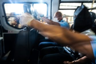 HONG KONG, CHINA - JULY 03: Members of media photograph a police van transporting a 24-year-old man who allegedly wounded a policeman with a knife during a protest on July 1 as it enters the Eastern Magistrates' Courts Building on July 03, 2020 in Hong Kong, China. (Photo by Billy H.C. Kwok/Getty Images)