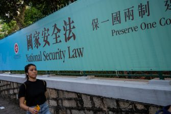HONG KONG, CHINA - JUNE 30: Pedestrians walks past a government-sponsored advertisement promoting a new national security law on June 30, 2020 in Hong Kong, China. (Photo by Billy H.C. Kwok/Getty Images)