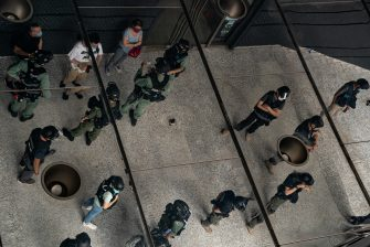 HONG KONG, CHINA - JULY 04: Riot police stop and search people as they celebrate the declaration of Independence of the United States outside the US Consulate General on July 4, 2020 in Hong Kong, China. Hong Kong marked the 23rd anniversary of the handover of the former British colony to China on July 1 hours after Beijing imposed the new national security law.  (Photo by Anthony Kwan/Getty Images)