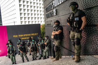 HONG KONG, CHINA - JULY 04: Riot police stand guard during a celebration fo the declaration of Independence of the United States near the US Consulate General on July 4, 2020 in Hong Kong, China. Hong Kong marked the 23rd anniversary of the handover of the former British colony to China on July 1 hours after Beijing imposed the new national security law.  (Photo by Anthony Kwan/Getty Images)