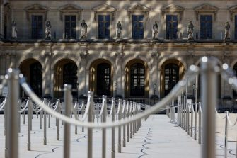 """A picture taken on June 23, 2020 shows the entrance to the Louvre Museum in Paris. - The Louvre museum will reopen its doors on July 6, 2020, after months of closure due to lockdown measures linked to the COVID-19 pandemic, caused by the novel coronavirus. The coronavirus crisis has already caused """"more than 40 million euros in losses"""" at the Louvre, announced its president and director Jean-Luc Martinez, who advocates a revival through """"cultural democratization"""" and is preparing a """"transformation plan"""" for the upcoming Olympic Games in 2024. (Photo by THOMAS SAMSON / AFP) (Photo by THOMAS SAMSON/AFP via Getty Images)"""