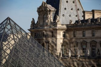 """A picture taken on June 23, 2020 shows the Louvre pyramid by Chinese architect Ieoh Ming Pei, the entrance to the Louvre Museum in Paris. - The Louvre museum will reopen its doors on July 6, 2020, after months of closure due to lockdown measures linked to the COVID-19 pandemic, caused by the novel coronavirus. The coronavirus crisis has already caused """"more than 40 million euros in losses"""" at the Louvre, announced its president and director Jean-Luc Martinez, who advocates a revival through """"cultural democratization"""" and is preparing a """"transformation plan"""" for the upcoming Olympic Games in 2024. (Photo by THOMAS SAMSON / AFP) / RESTRICTED TO EDITORIAL USE - MANDATORY MENTION OF THE ARTIST UPON PUBLICATION - TO ILLUSTRATE THE EVENT AS SPECIFIED IN THE CAPTION (Photo by THOMAS SAMSON/AFP via Getty Images)"""