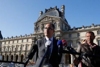 """Louvre museum director Jean-Luc Martinez answers journalists' questions in front of the Louvre Museum in Paris, on July 6, 2020, on the museum's reopening day. - The Louvre museum will reopen its doors on July 6, 2020, after months of closure due to lockdown measures linked to the COVID-19 pandemic, caused by the novel coronavirus. The coronavirus crisis has already caused """"more than 40 million euros in losses"""" at the Louvre, announced its president and director Jean-Luc Martinez, who advocates a revival through """"cultural democratization"""" and is preparing a """"transformation plan"""" for the upcoming Olympic Games in 2024. (Photo by FRANCOIS GUILLOT / AFP) (Photo by FRANCOIS GUILLOT/AFP via Getty Images)"""