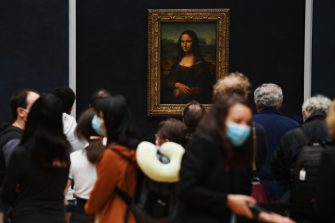 PARIS, FRANCE - JULY 06: Visitors queue observing social distancing marking to see Leonardo da Vinci's 'Mona Lisa' at the Louvre museum as it reopens its doors following its 16 week closure due to lockdown measures caused by the COVID-19 coronavirus pandemic, at the Louvre on July 6, 2020 in Paris, France. (Photo by Pascal Le Segretain/Getty Images)