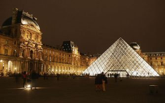 """PARIS - AUGUST 24:  The Pyramide of the Louvre museum designed by I.M. Pei is seen on August 24, 2005 in Paris, France. Dan Brown is the author of numerous  bestsellers, including Digital Fortress, Angels and Demons, and Deception Point. His acclaimed novel """"The Da Vinci Code""""has become one of the most widely read books of all time.  (Photo by Pascal Le Segretain/Getty Images)"""