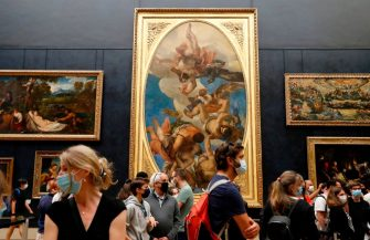 """People wearing face masks visit the Salle des  Etats, at the Louvre Museum in Paris on July 6, 2020, on the museum' s reopening day. - The Louvre museum will reopen its doors on July 6, 2020, after months of closure due to lockdown measures linked to the COVID-19 pandemic, caused by the novel coronavirus. The coronavirus crisis has already caused """"more than 40 million euros in losses"""" at the Louvre, announced its president and director Jean-Luc Martinez, who advocates a revival through """"cultural democratization"""" and is preparing a """"transformation plan"""" for the upcoming Olympic Games in 2024. (Photo by FRANCOIS GUILLOT / AFP) (Photo by FRANCOIS GUILLOT/AFP via Getty Images)"""