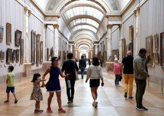 """People wearing face masks visit the Louvre Museum in Paris on July 6, 2020, on the museum' s reopening day. - The Louvre museum will reopen its doors on July 6, 2020, after months of closure due to lockdown measures linked to the COVID-19 pandemic, caused by the novel coronavirus. The coronavirus crisis has already caused """"more than 40 million euros in losses"""" at the Louvre, announced its president and director Jean-Luc Martinez, who advocates a revival through """"cultural democratization"""" and is preparing a """"transformation plan"""" for the upcoming Olympic Games in 2024. (Photo by FRANCOIS GUILLOT / AFP) (Photo by FRANCOIS GUILLOT/AFP via Getty Images)"""