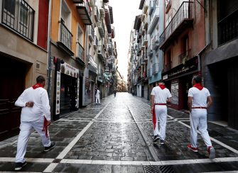 epa08531788 Three mozos, or runners, walk along an almost empty Estafeta street, a section of the running-the-bulls route, during an atypical 07 July without 'encierros', runners and bulls, in Pamplona, northern Spain, 07 July 2020. Pamplona's Running of the Bulls, known as the Sanfermines, would have normally kicked off on 06 July. However, the bull-running festival has been canceled this year due to the ongoing pandemic of the COVID-19 disease caused by the SARS-CoV-2 coronavirus. The festival of San Fermin is held annually from 06 to 14 July in commemoration of the city's patron saint. Hundreds of thousands of visitors from all over the world attend the fiesta. Many of them physically participate in the highlight event - the running of the bulls, or encierro - where they attempt to outrun the animals along a route through the narrow streets of Pamplona's old city.  EPA/Jesus Diges