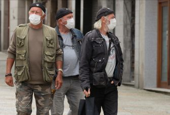 epa08532257 Residents wearing face masks walk along a street in the town of Viveiro, inside A Marina area, in Galicia, northwestern Spain, 07 July 2020. Regional authorities declared the lockdown in A Marina area, made up of 14 towns, until 10 July as the total number of COVID-19 cases reaches 121, so far.  EPA/ELISEO TRIGO