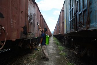 epaselect epa08530672 A worker sprays disinfectant on trains to contain the spread of Covid19 coronavirus, during the total lockdown in Guwahati, India, 06 July 2020. Guwahati is the worst coronavirus-affected city in Assam and began a strict, two-week lockdown from the evening of 28 June 2020.  EPA/STR