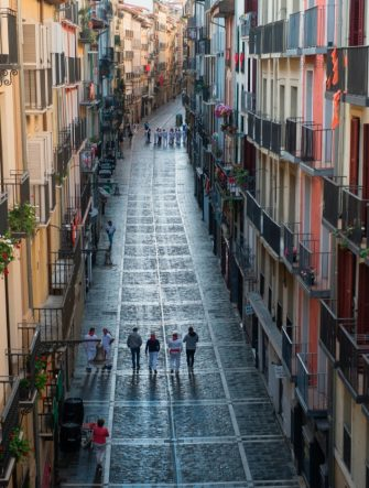 Participants walk along Estafeta street during the symbolic celebration of the first bullrun of the San Fermin festival in Pamplona, northern Spain, on July 7, 2020. - The 2020 edition of the San Fermin Festival has been cancelled as part of preventive measures to fight the spread of the novel coronavirus. (Photo by ANDER GILLENEA / AFP) (Photo by ANDER GILLENEA/AFP via Getty Images)