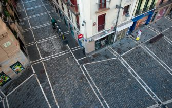 A reveller turns the empty corner of Estafeta street during the symbolic celebration of the first bullrun of the San Fermin festival in Pamplona, northern Spain, on July 7, 2020. - The 2020 edition of the San Fermin Festival has been cancelled as part of preventive measures to fight the spread of the novel coronavirus. (Photo by ANDER GILLENEA / AFP) (Photo by ANDER GILLENEA/AFP via Getty Images)