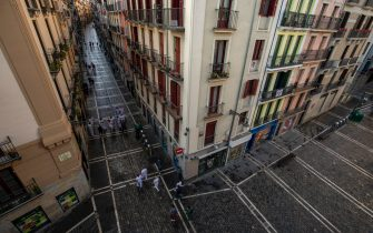 PAMPLONA, SPAIN - JULY 07: People walk along Estafeta Street after the San Fermin Festival was cancelled earlier this year, on July 07, 2020 in Pamplona, Spain. The annual Bull-Running Festival was canceled this year 2020 due to the Coronavirus (COVID-19) pandemic, The last time this happened was in 1938, during the Spanish Civil War. (Photo by Pablo Blazquez Dominguez/Getty Images)