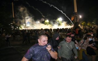 BELGRADE, SERBIA - JULY 08: Police use tear gas against protesters in front of the Serbian parliament during a protest against a lockdown planned for the capital this weekend to halt the spread of the coronavirus disease (COVID-19) on July 8, 2020 in Belgrade, Serbia. (Photo by Srdjan Stevanovic/Getty Images)