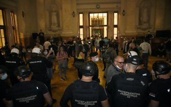 BELGRADE, SERBIA - JULY 08: Protesters who entered inside of the Serbian parliament were surrounded by police during the protest against a lockdown planned for the capital this weekend to halt the spread of the coronavirus disease (COVID-19) on July 8, 2020 in Belgrade, Serbia. (Photo by Srdjan Stevanovic/Getty Images)