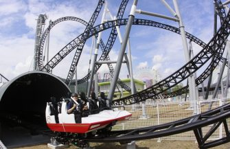 "A man prepares to ride on Fuji-Q Highland amusement park world's steepest roller coaster ""Takabisha"" with a free falling angle of 121 degrees, at a press preview at Fujiyoshida city in Yamanashi prefecture on July 8, 2011. The  Takabisha stands 43m tall and is 1,000m in distance and will open at the park on the foothills of Mt. Fuji on July 16.   AFP PHOTO / Yoshikazu TSUNO (Photo credit should read YOSHIKAZU TSUNO/AFP via Getty Images)"