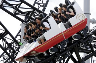 "People react as they ride on Fuji-Q Highland amusement park world's steepest roller coaster ""Takabisha"" with a free falling angle of 121 degrees, at a press preview at Fujiyoshida city in Yamanashi prefecture on July 8, 2011. The  Takabisha stands 43m tall and is 1,000m in distance and will open at the park on the foothills of Mt. Fuji on July 16.   AFP PHOTO / Yoshikazu TSUNO (Photo credit should read YOSHIKAZU TSUNO/AFP via Getty Images)"