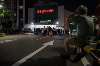 Media and spectators gather outside the Seoul National University hospital on Jul 9, 2020, following unconfirmed reports that Seoul Mayor Park Won-soon had been taken there after being reported missing earlier in the day. (Photo by Ed JONES / AFP) (Photo by ED JONES/AFP via Getty Images)