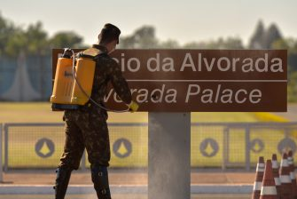 BRASILIA, BRAZIL - JULY 09: A Brazilian army soldier disinfects the outside area of the presidential residence, Alvorada Palace, amidst the coronavirus (COVID-19) pandemic on July 9, 2020 in Brasilia, Brazil. President of Brazil Jair Bolsonaro has tested positive for COVID-19. (Photo by Andre Borges/Getty Images)
