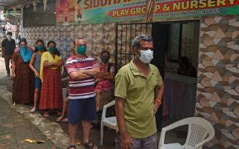 Residents stand in a queue as they wait for their turn to get screened during a medical screening for the COVID-19 coronavirus, at a residential society in Mumbai on July 10, 2020. - Hospitals in densely populated cities such as Mumbai and Delhi are struggling to cope with the epidemic, and the country now has around 720,000 infections -- the world's third-highest. (Photo by Punit PARANJPE / AFP) (Photo by PUNIT PARANJPE/AFP via Getty Images)